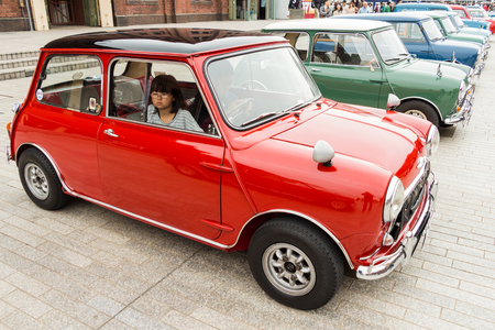 Yokohama Kanagawa, Japan - November 9  Unidentified girl on a Mini Cooper in Yokohama Historic Car Day 2013 at Yokohama Red Brick Warehouse on November 9, 2013 in Kanagawa, Japan