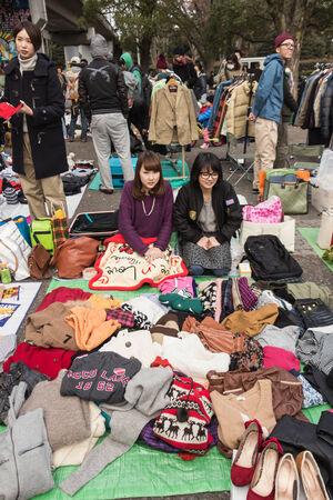 harajuku: Harajuku, Japan - December 8, 2013  Seller sell the second hand clothes at flea market in Yoyogi Park, Harajuku  It is the winter flea market in the city of fashion Harajuku, Japan