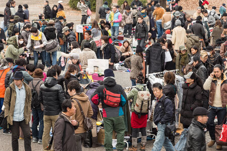 Harajuku, Japan - December 8, 2013  Shoppers come to flea market at Yoyogi Park in Harajuku  It is the winter flea market in the city of fashion Harajuku, Japan