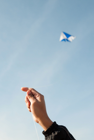 kite flying in a blue sky and clouds