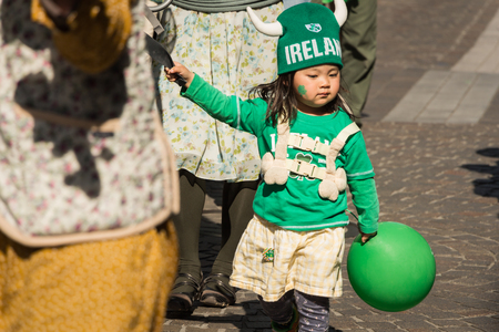 joins: Yokohama, Japan - March 16, 2013  Unidentified child joins the parade for St  Patrick Editorial
