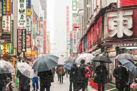 Shinjuku, Japan - February 14, 2014  Japanese people walks on the street during snow storm in Shinjuku, Tokyo