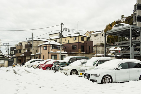 Tokyo, Japan - February 15, 2014  The cars in the parking area after snow storm passes in Tokyo city