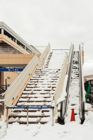 departmentstore: The escalator out of service after snow storm passes at a department store in Tokyo city
