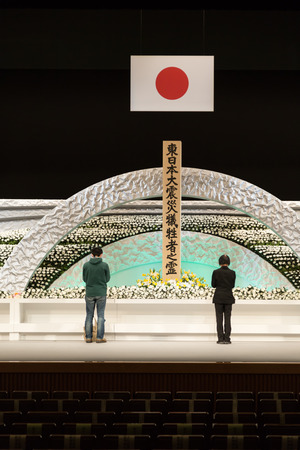 Tokyo, Japan - March 11, 2014  Japanese people bring flowers and pray for the victims of earthquake and nuclear disaster in Tohoku 2011 at Japan National Theatre, Tokyo, Japan biên tập