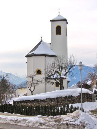 extreme angle: Beautiful church in mountain scenery. Stock Photo