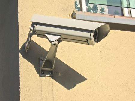 Security camera on the wall  photo