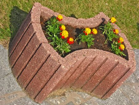 Stone flowerbed with flowers  photo