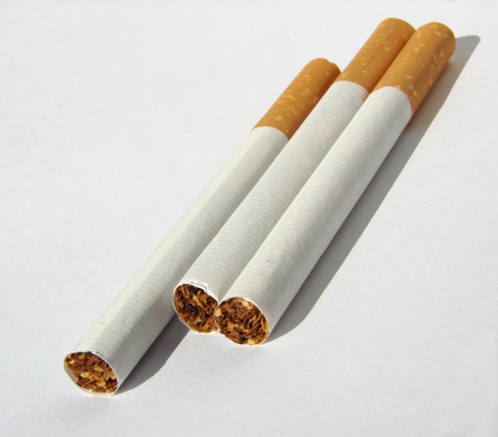 unhealthiness: few cigarettes with shadow on the white background Stock Photo