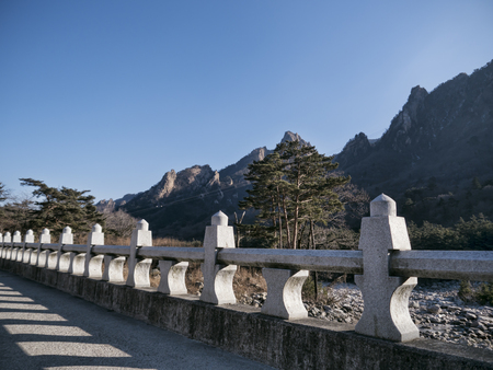 The stone bridge and beautiful mountains on the background in Seoraksan National Park, South Korea