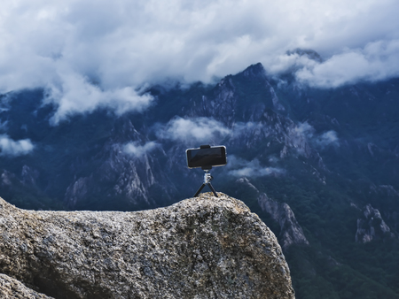 Phone on a tripod on high mountain peak, Seoraksan National Park, South Korea 版權商用圖片