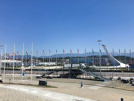 SochiRussia - August 2019: Big flags and olympic objects in Olympic Park