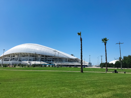 Adler city Russia - August 2019: The view to Fisht stadium with palm trees
