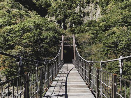 Suspension bridge on Hallasan volcano. Front view Stok Fotoğraf