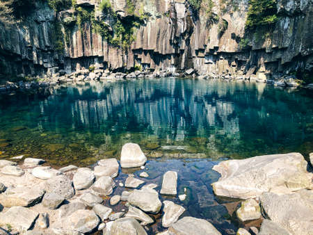 Mountain lake with stones in Jeju island. South korea Banco de Imagens