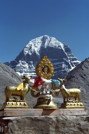 jainism: The main Buddhist symbol Dharmachakra on the roof of Buddhist monastery Driraphuk gompa at the North Face of sacred Mount Kailash in Western Tibet.