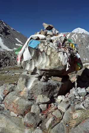 jainism: Sacred stones with recesses wiped by prayer beads of many pilgrims who went the ritual route around Holy Mount Kailash in Western Tibet.