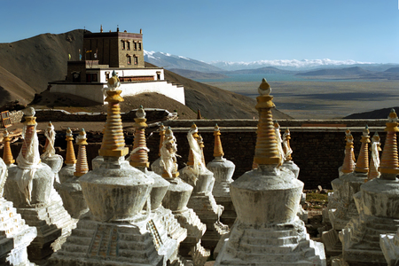 View to the Buddhist monastery Gyantak gompa and ritual structures Stupas on the hillside of sacred Mount Kailash in Western Tibet. Stock Photo