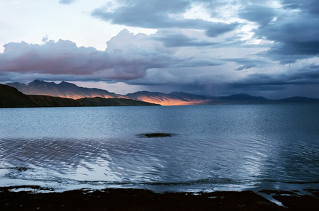 jainism: Sunset light at the sacred Lake Manasarovar (4557m above sea level) in Western Tibet. Stock Photo