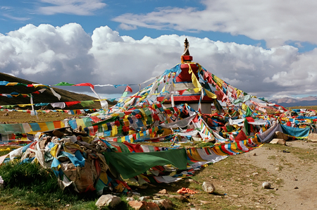 jainism: Tibetan ritual stupa and prayer flags with mantras.