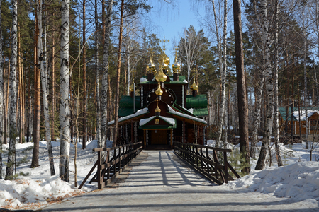 Wooden Russian Orthodox Christian Church of St. Nicholas in Ganina Yama Monastery on early Spring, Ekaterinburg, Russia. Stock Photo