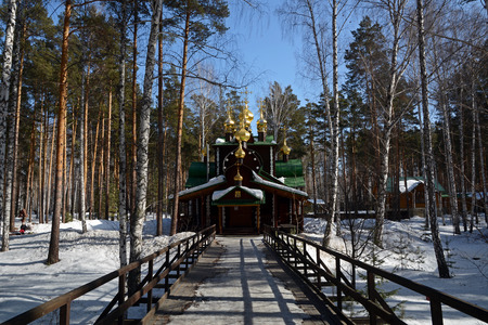 Wooden Russian Orthodox Christian Church of St. Nicholas in Ganina Yama Monastery on early Spring, Ekaterinburg, Russia. Stock Photo
