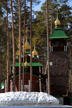 Wooden Russian Orthodox Christian Church of St. Sergius of Radonezh in Ganina Yama Monastery on early Spring, Yekaterinburg, Russia. Stock Photo