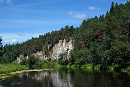 Cliff St. George Rock on the shore of Chusovaya river, Sverdlovsk Region, Russia.