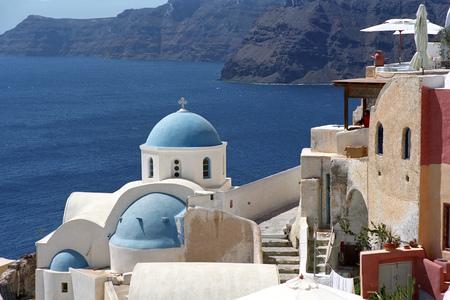 Greek traditional Orthodox Christian church in Oia village on the edge of volcano caldera of Santorini island, Greece.