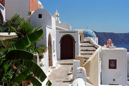 Oia village street on the edge of volcano caldera of Santorini island, Greece. Stock Photo