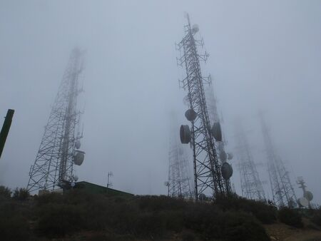 Radio towers in fog