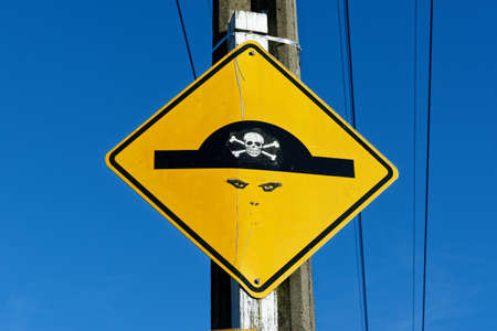 A beware of the speed bump sign has been changed with graffiti to turn it into a pirate