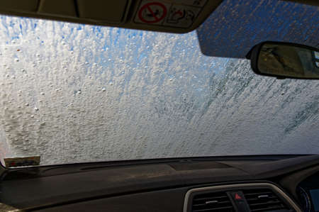 A car window being washed at a car wash