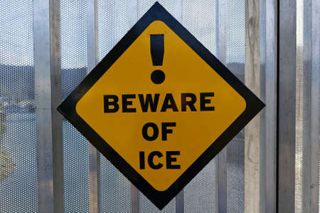 A Beware Of Ice sign warns pedestrians of the chance of slipping