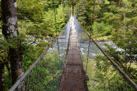 A suspended swing bridge used for crossing rivers in New Zealand, it is hung by cables.
