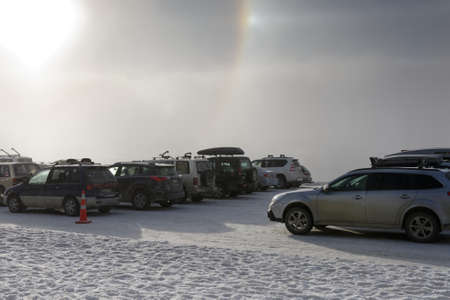 Nature and man, a ski field car park is enhanced by a sun halo 版權商用圖片
