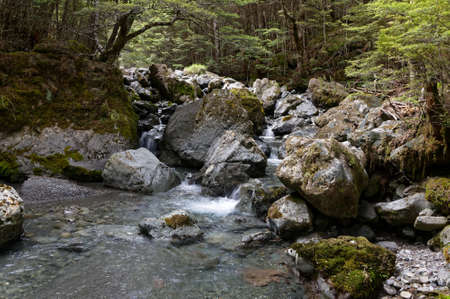Large boulders form part of a river bed in New Zealand