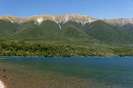 Mountains were thrust up by the continental collision to form the backdrop to the glacial lake, Lake Rotoiti in New Zealand