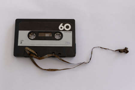 A cassette tape has its tape broken