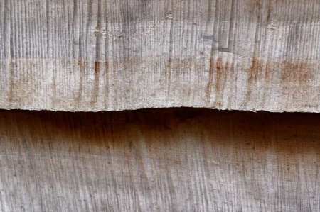 Rough sawn timber is used as planks, overlapping each other in hut construction