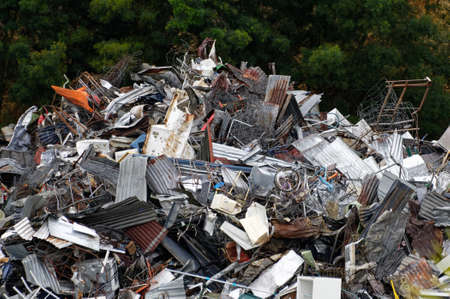 A dump of metal rubbish, man's waste accumulating in a large pile