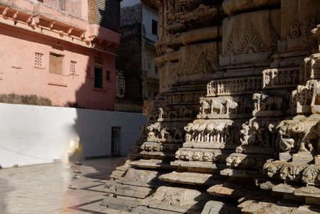 An indian woman walks past the temple in Udaipur