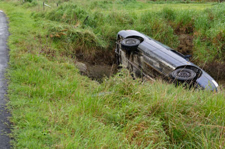 A car accident, the vehicle has left the road and is on its side 版權商用圖片