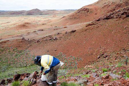 ductile: Exploration Geologist Sampling Archean Rocks - Pilbara - Australia