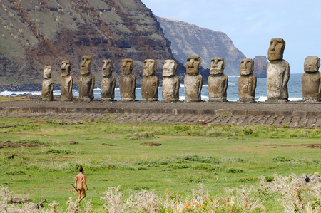 easter island: Local Polynesian with Tongariki Moais - Easter Island Stock Photo