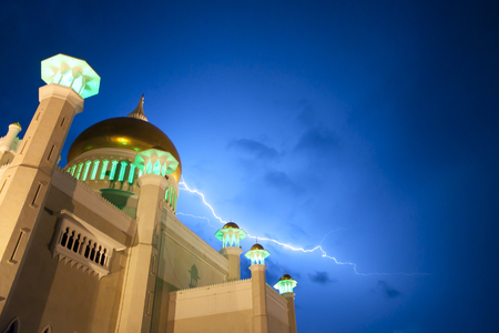 omar: Lightning near Sultan Omar Ali Saifuddin Mosque - Brunei Stock Photo