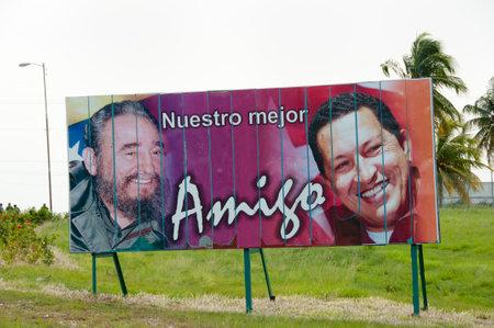 hugo: HAVANA, CUBA - June 10, 2015: Billboard depicting Fidel Castro & Hugo Chavez. The sentence says our best friend. Editorial