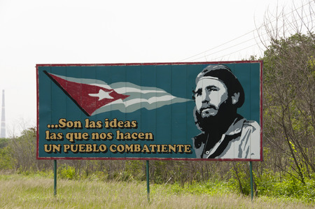 stating: HAVANA, CUBA - June 10, 2015: Revolution poster of young Fidel Castro stating that ideas make us a fighting nation Editorial