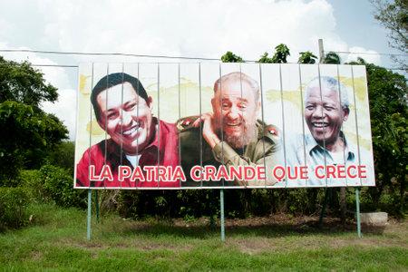 HAVANA, CUBA - June 10, 2015: Billboard depicting Fidel Castro, Hugo Chavez & Nelson Mandela. The sentence says the native land that grows.