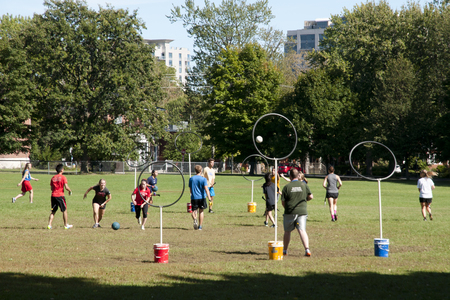 harry: KINGSTON, CANADA - September 20, 2015: Mixed players from Queens University practice the game of quidditch from the Harry Potter series